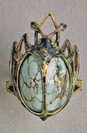 Georges Fouquet - An Art Nouveau gold, enamel and turquoise Beetle ring, after 1904. Stamped G. Fouquet. Consisting of an oval turquoise cabochon set in 'cage' of gold, enamelled green, which defines the insect shape. Source: From Slave to Siren: Dora Jane Janson. #Fouquet #ArtNouveau #ring