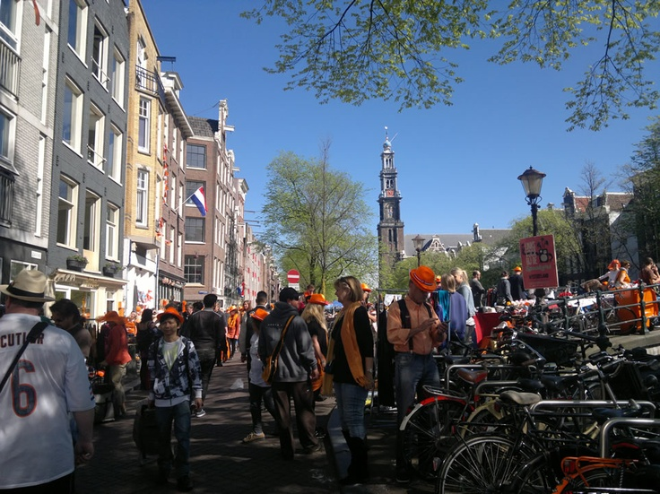 Westerkerk bell tower tolls its tunes tall and proud above the crowds on Queen's Day 2012.