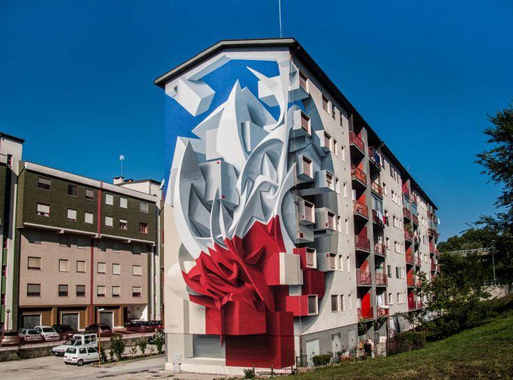 Manuel Di Rita, mais conhecido como Peeta, é um artista de murais e grafites italiano criador de peças em 3D que impressionam pelas formas volumétricas e abstratas. Uma combinação harmônica de luz, sombra, texturas e cores vibrantes concedem a suas figuras um efeito extraordinário. A sensação é que grandes esculturas estão realmente saindo da parede....