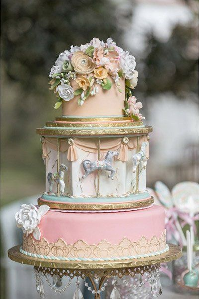 A carousel tier makes this adorable cake even sweeter. The perfect cake for your fairy tale wedding!   David Manning Photographers