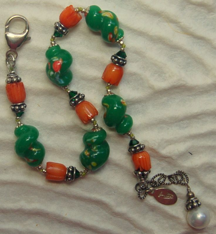 A personal favorite from my Etsy shop https://www.etsy.com/listing/243114335/hand-knotted-semi-precious-coral-and