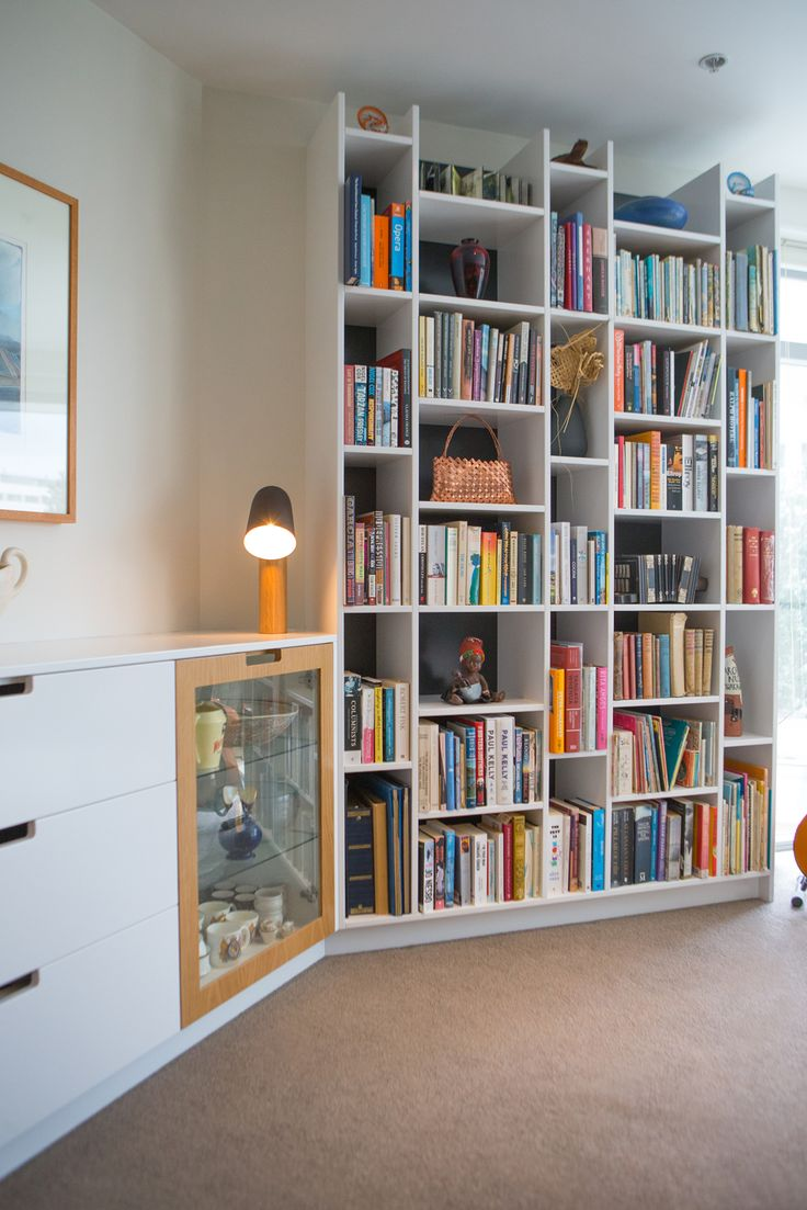 Furniture 601. Sally Steer Design Ltd. Wellington, New Zealand. Bookcase and storage in white with Oak plywood features.