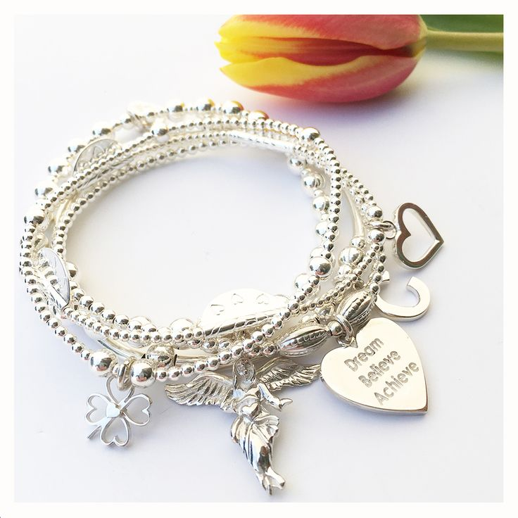 Everyone's favourite 5 strand 925 sterling silver hand-beaded My Guardian Angel Charm bracelet with a lucky Four-Heart Clover charm, Open Heart charm and our signature My Guardian Angel charm. Personalise with a solid sterling silver initial and choose from 15 mottos for the 925 sterling silver heart charm.