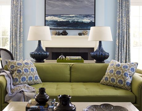 """Blues and greens...they love each other (check out a colour wheel if you don't believe me!)  Completely calming and oh so pretty! Notice how your eye is """"pulled' through the space right from the couch to the painting.  Well done! (housebeautiful)"""
