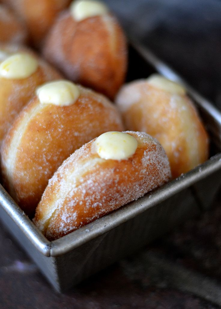 Meyer Lemon Cream Doughnuts | Airy yeast donuts, rolled in sugar and then filled with a creamy, tart Meyer lemon filling.