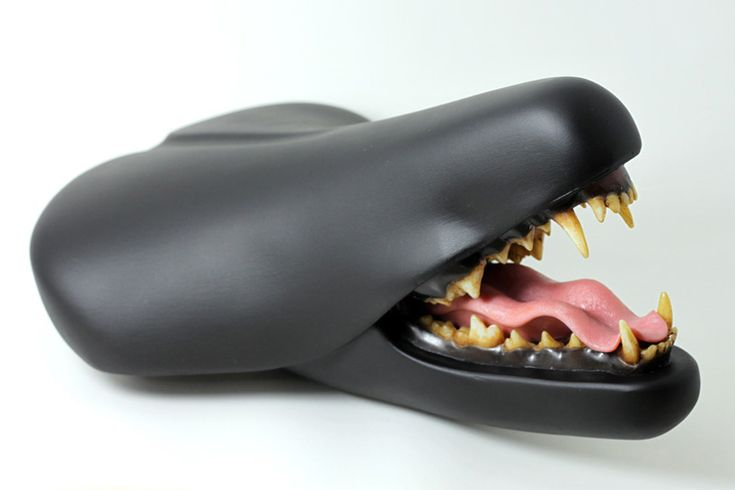 clem chen inserts taxidermy molds into 'bite it' bike seat sculpture