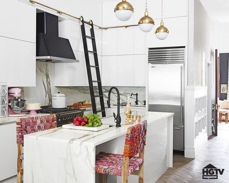 Genevieve Gorder's kitchen: Calacutta Borghini marble. Black and gold accents. Chairs made of recycled woven saris.