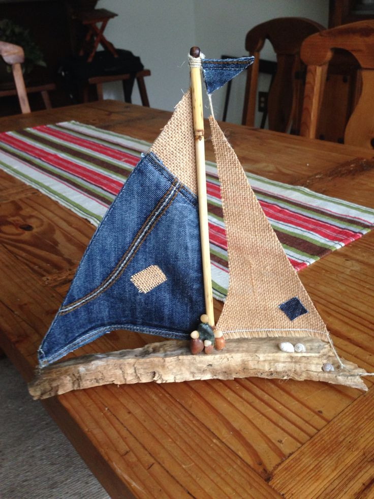 Driftwood sailboat with jean and burlap