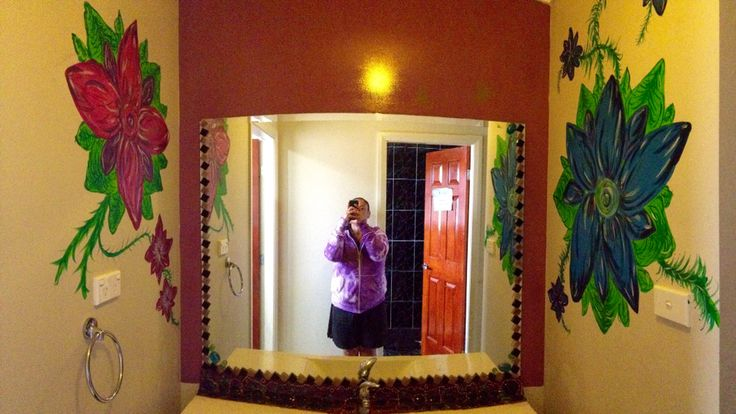Panorama of my bathroom vanity and sidewall flowers I hand painted to brighten up space