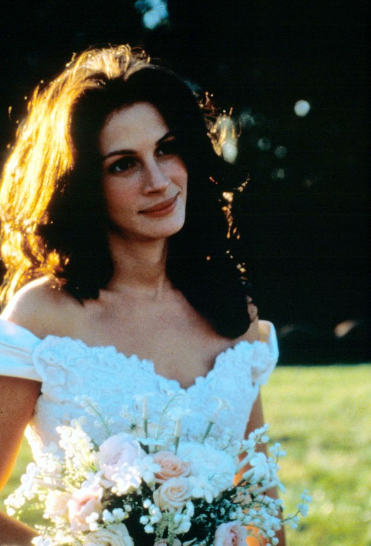 The 27 Most Iconic Movie Wedding Dresses of All Time - Runaway Bride      She wears plenty of wedding dresses in the movie, but perhaps our favorite is the only one Maggie Carpenter (Julia Roberts) manages to actually get married in: this off-the-shoulder gown by Amsale.