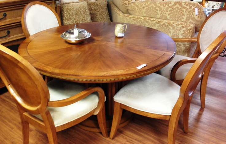 "table - 54"" round x 72"" - and six chairs ($550)"