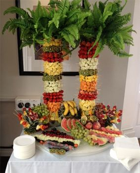 Fruit Palm Trees and Fruit Slices on display table