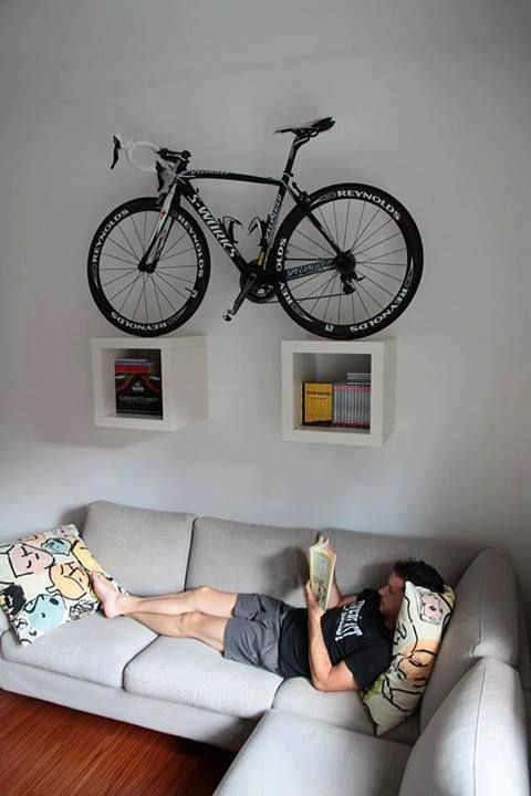 bike storage ideas and modern interior design Here is a collection of space-saving bike storage ideas that give sports enthusiasts great inspirations and help decorate their home interiors in a unique, sport-inspired, and creative style Hanging Bike Rack, Bike Hanger, Indoor Bike Rack, Indoor Bike Storage, Bicycle Wall Mount, Bike Mount, Bike Storage Apartment, Bike Storage Living Room, Velo Design