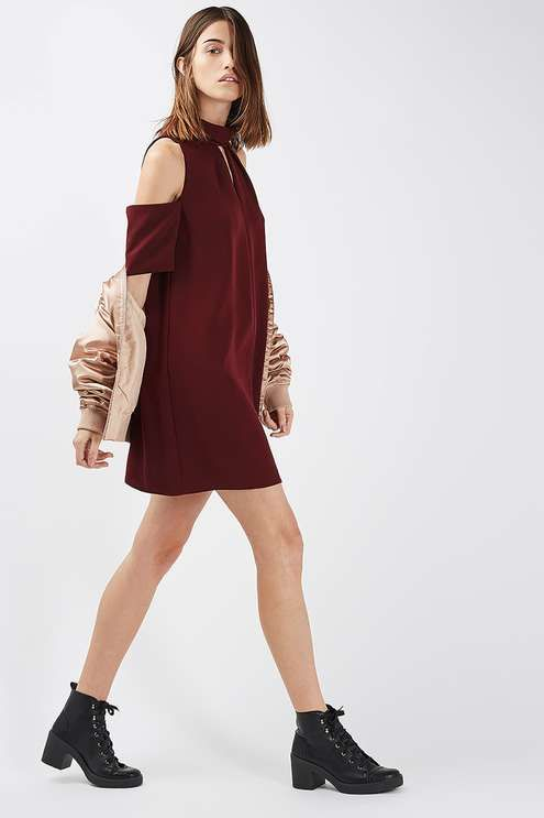 We're still loving the cold shoulder trend, seen here in the form of this burgundy dress with a funnel neck and cool keyhole detail to the front. Team with ankle boots and a leather jacket to add a dose of edge to the look. #Topshop