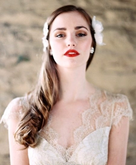 Bride's long down hair with side flowers wedding hairstyle