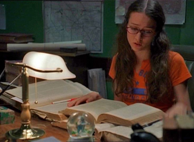 Winifred Burkle - second cutest geek in the universe that is Joss. Played by Amy Acker, during a scene from Angel, showing the power of knowledge.