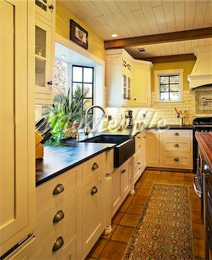 Spanish style kitchen. LIKE DRAWER PULLS AND COUNTER TOP & FLOOR