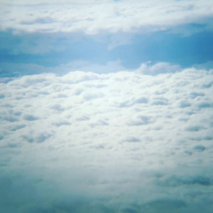 High above the clouds #fluffy #white #clouds #flying @airbaltic