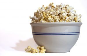 Fill a brown paper lunch sack with 1/4 cup popcorn kernels and around a tsp. of oil . Microwave for 1-3 Minutes