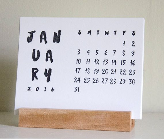 Set with calligraphic script, these super limited edition calendars are printed on premium cotton paper in black ink with a nice, tactile impression. Each month is an individual card, and all of the cards sit neatly in a hand made wooden base. Simply move the old month to the back of the stack so that the cards sit properly in the base throughout the year.  Each base is unique and was hand cut and sanded, and each month was hand pulled on an antique letterpress. Only 75 total  were made.