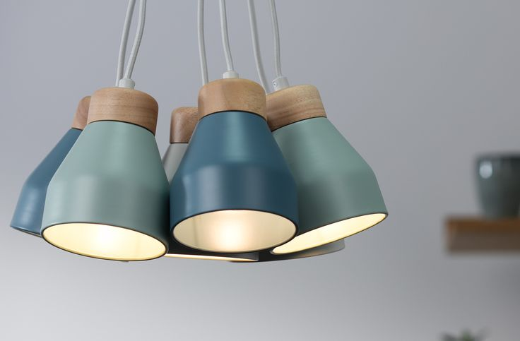 Designed in house by MADE Studio, each lamp features a rubberwood top and a metal shade in a trio of muted colours. The shades are powder coated inside and out for a seamless effect. £79 | MADE.COM