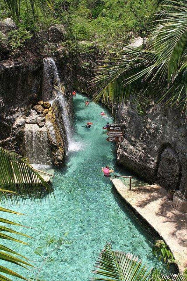 Floating Down the River Of Xcaret, Riviera Maya. Xcaret is a Maya civilization archaeological site located on the Caribbean coastline of the Yucatán Peninsula, in the modern-day state of Quintana Roo in Mexico.