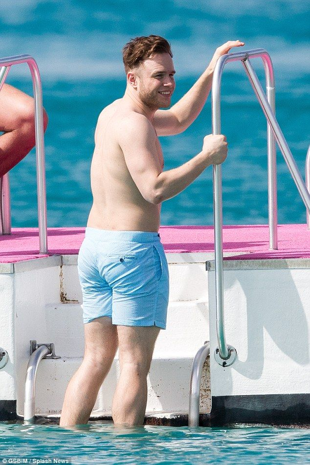 Tight light blue shorts modelled by Olly Murs (1984), Barbados January 2016