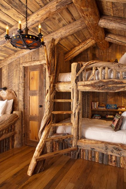 Snow White and the Seven Dwarfs. This wood-clad bedroom resembles the pretty house of the seven dwarfs, where Snow White finds refuge. It's easy to imagine the joy of the children lucky enough to bunk here. Sleeping in this room could feel just like taking a nap at the tip of a tree or embarking on an epic nocturnal tale. Wonder feature: The ladder for the bunk beds is made of tree branches. Rustic Bedroom by Lohss Construction