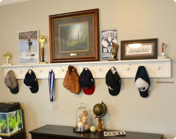 DIY Ideas | I love this bead board peg shelf that was made for a sports-loving boy's bedroom. It's perfect for decorating a large wall - and storing all those baseball caps!