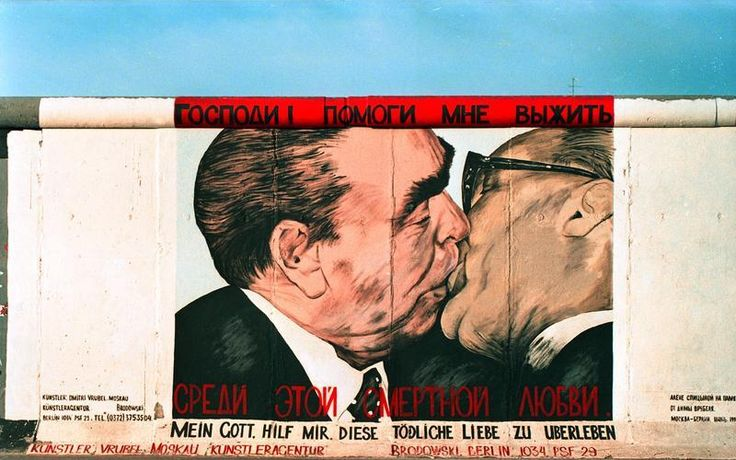 "A picture of East German leader Erich Honecker kissing Soviet leader Leonid Brezhnev became famous and an icon of the Cold War.[8] The passionate kiss depicted was in a satirical mural entitled ""My God, help me to survive this deadly love"", (German: Mein Gott, hilf mir, diese tödliche Liebe zu überleben), sometimes referred to as the Fraternal Kiss (German: Bruderkuß), on the Berlin Wall (East Side Gallery), painted by artist Dmitri Vrubel."