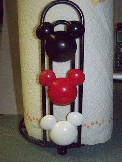 Mickey Mouse Paper Towel Holder for the kitchen- made from a cheap paper towel holder and shower curtain rings.  Less than five dollars!