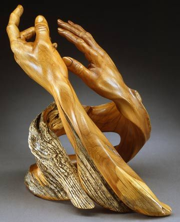 "'Eternal Dance' - wood carving by J. Christopher White;  carved from West Texas Juniper (2005);  12"" x 11"" x 10"";   photo by Mel Schockner"