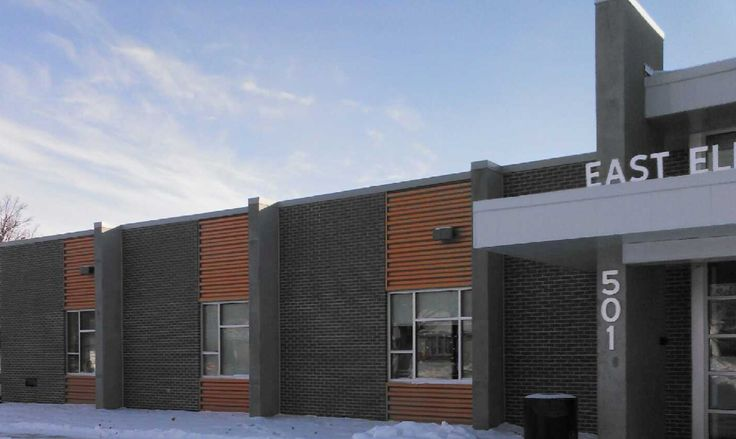 Precast; Concrete; Sheldon Safe Room / Gym - Sheldon, IA; General Contractor: Wiltgen Construction, Inc.; Architect/Engineer: Cannon Moss Brygger Architects; Products: Double Tees, Insulated Wall Panels, Wall Panels; Finishes: Sandblast, Water Wash
