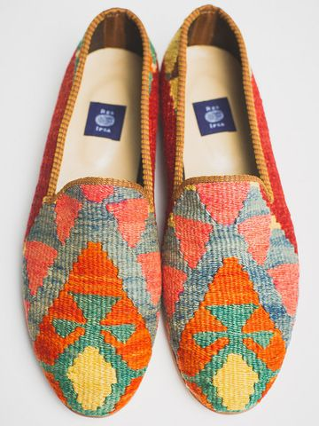 Inspired by a visit to Istanbul, each loafer is handmade, crafted from vintage hand-woven Turkish rugs, and finished with a durable leather sole and rubber heel.  Because each Turkish rug is unique and asymmetrical, no two pairs will ever be identical. This is a one-of-a-kind product with an international flair.   This pair of loafers is a one-of-a-kind. It is literally impossible to create two identical pairs of shoes, so the shoes you receive will be competely unique, never to be exactly…
