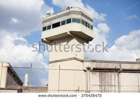 stock-photo-prison-tower-and-walls-surrounded-by-gate-270426470.jpg (450×320)