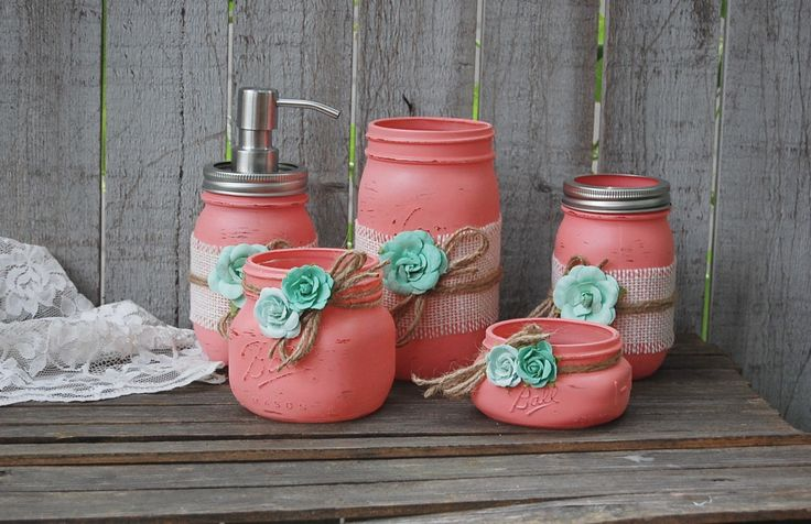 Rustic mason jar bathroom jar set. Hand painted in coral, wrapped with white burlap, tied with jute and mint green roses, finished with a protective coating. Metal soap dispenser, toothbrush holder, m