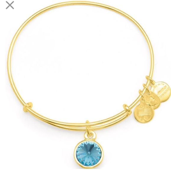 Alex and Ani March Birthstone Bangle  Alex and Ani March Birthstone Bangle  worn and has a bit of wear of the gold rubbing off but otherwise in great condition! no trades  Alex & Ani Jewelry Bracelets