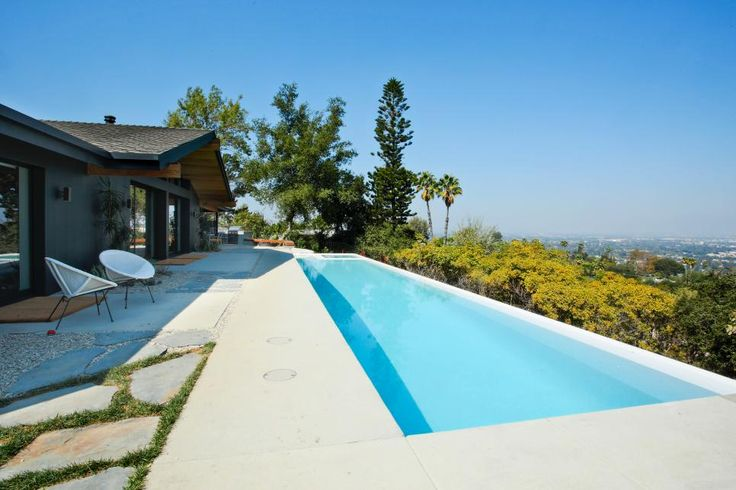 A lovely backyard with infinity pool at host Jennie Garth's Hollywood Hills home after renovations, as seen on The Jennie Garth Project.