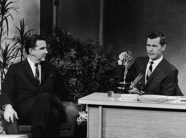 Johnny Carson began his 29 1/2 year run as the host of The Tonight Show.  He is the high-water mark in on-air chic.  Carson was king of class, comedic timing, and casual cool.