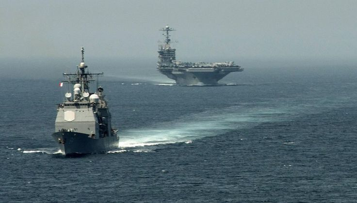 The American Ticonderoga class guided-missile cruiser USS Gettysburg (CG64) & the aircraft carrier USS Harry S. Truman (CVN75) in the Straits of Gibraltar in early August. (AFP Photo)