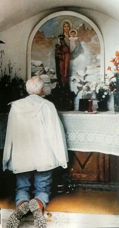 Jean Paul II stops to pray during a walk in the Northern Italian hills.