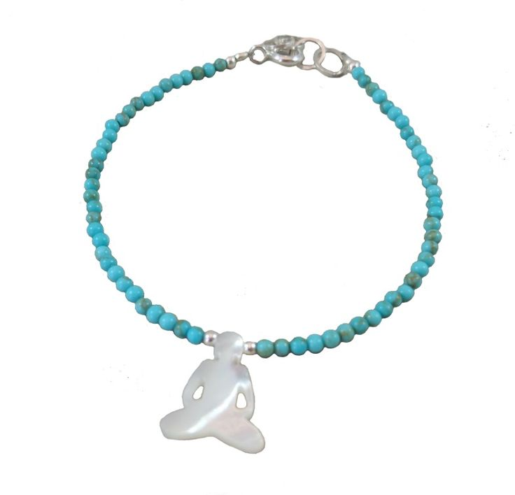 Summer style bracelet with turquoise gemstone and yoga figure made from seashells.
