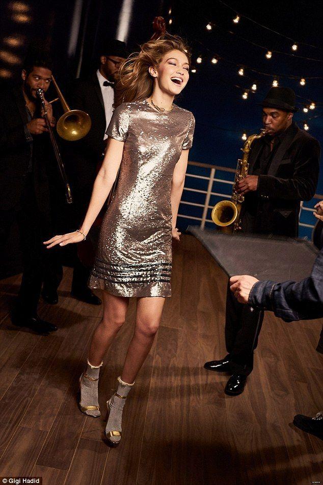 Gigi Hadid´s  sequinned gold mini dress, lurex ankle socks and gold sandals