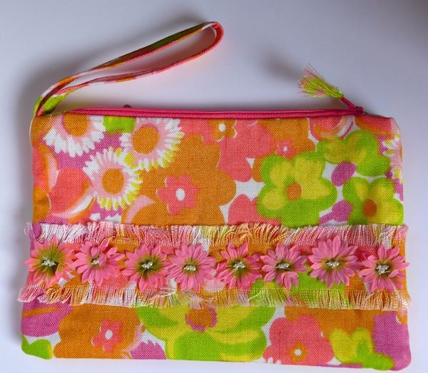 Super floral clutch bag made in vintage 1970s linen. Lined with vintage silk kimono lining. Wrist strap makes it easy to use.  See it and more at www.artefice.co.uk