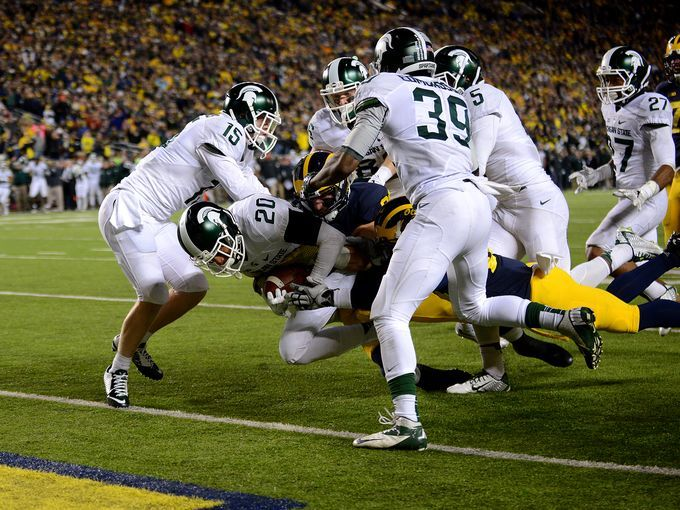 Jalen Watts-Jackson (20) crosses the goal line to score the winning touchdown after time expired to claim the win and the Paul Bunyan trophy for Michigan State in a 27-23 over Michigan Saturday, October 17, 2015, at Michigan Stadium in Ann Arbor. Watts-Jackson recovered a muffed punt for a touchdown.   Dave Wasinger/Lansing State Journal