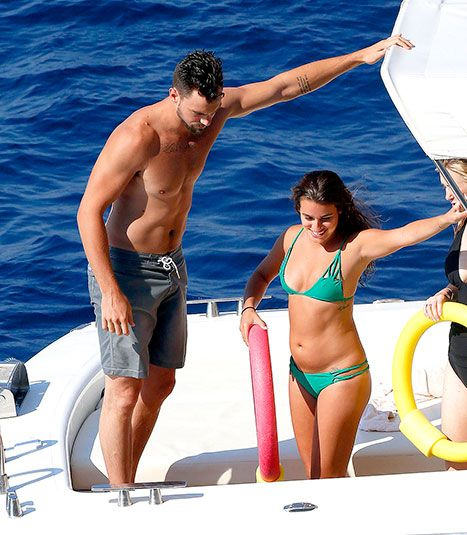 Lea Michele was photographed kissing her new boyfriend Matthew Paetz while wearing a skimpy green bikini on a boat in Italy