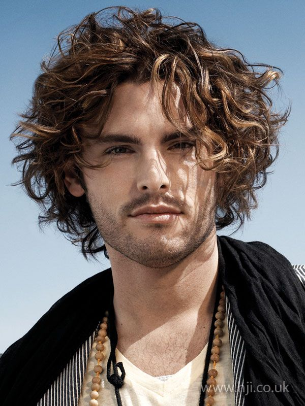 Mid length curly hairstyle for men