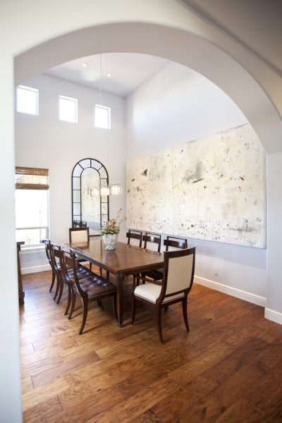 Mimicking the arches throughout this sophisticated Kerrie Kelly Design Lab home, Uttermost's Dillingham Black Arch Mirror, #10505, provides a perfect compliment to this dining room's statement artwork.