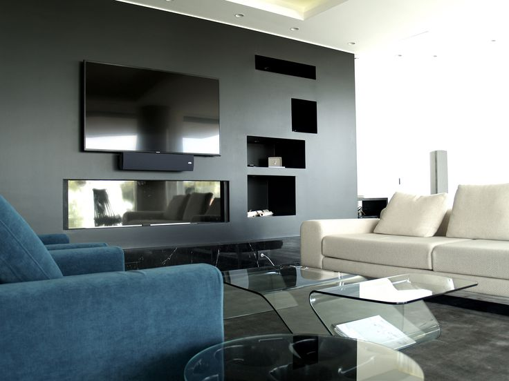 Contemporary style living room with a stunning black fireplace.