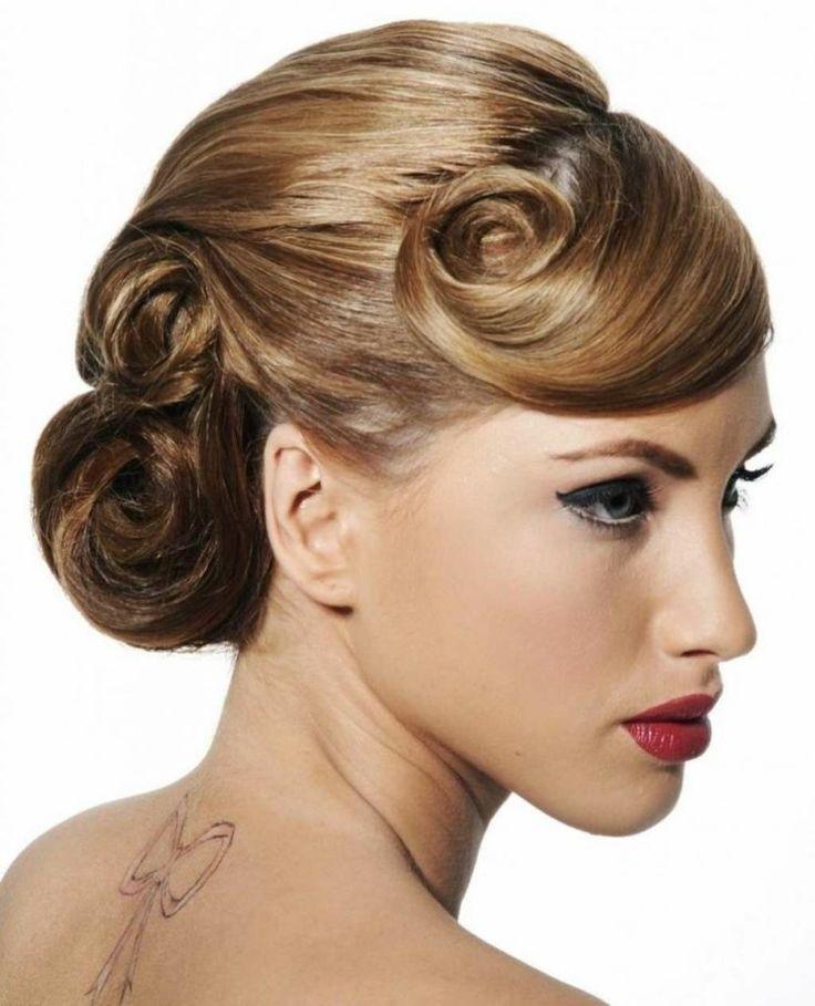 Hochsteckfrisur im Rockabilly Stil mit mehreren Pin up Curls